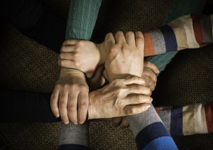Many hands together. Interior shot